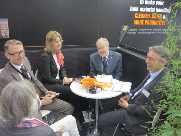 Discussion at Martin Engineering's booth: (from left to right) Johannes C. Häring, Business Development Manager, OWP Ost-West-Partner GmbH Christiana Breier, LL.M., Business Development Manager, OWP Ost-West-Partner GmbH Jochen Baumgartner, Director, Bulk Academy Wiesbaden Stefan Zöbisch, E+H Endress + Hauser