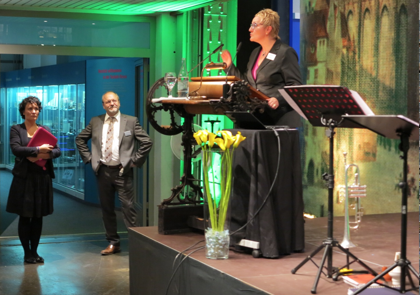 Petra Wolf, Member of the Management Board, addressing the visitors at the Museum Reception and Claus Rättich, Member of the Management Board,
