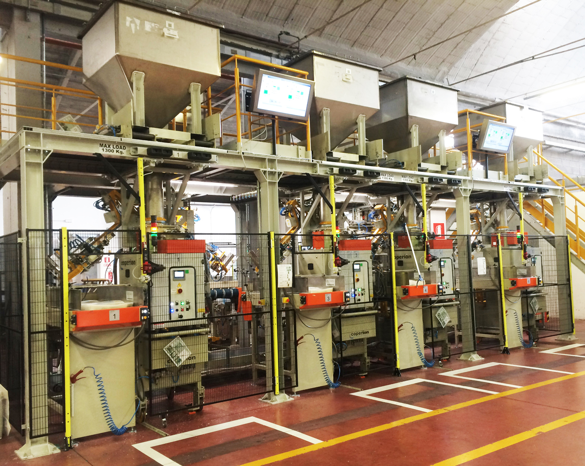 Packaging machines with mobile feeding hoppers on top and local displays (Image: Coperion, Ferrara, Italy)