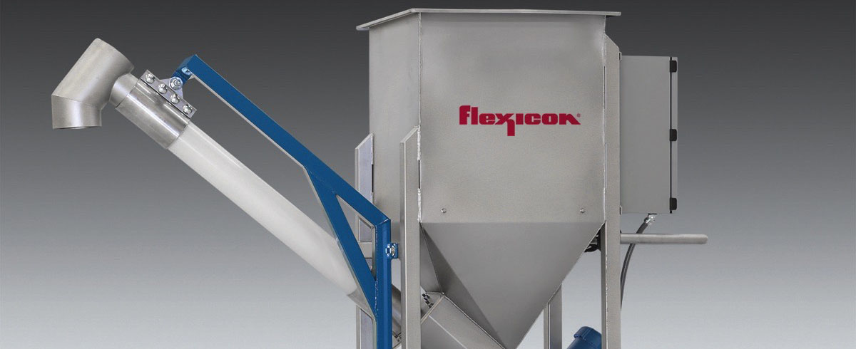 Flexicon: Low-profile Flexible Screw Conveyor rolls under Mezzanines, discharges anywhere