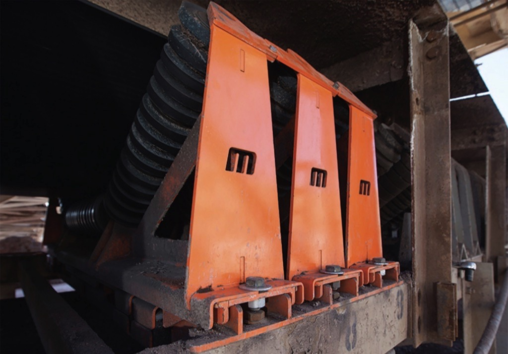 Martin Engineering: Reduce Conveyor Maintenance Time through better Access - Track-mounted idlers allow easy access for quickly swapping out seized rollers.
